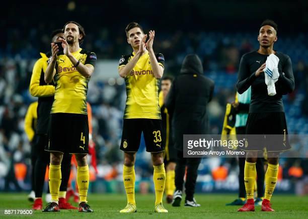Neven Subotic of Borussia Dortmund Julian Weigl of Borussia Dortmund and PierreEmerick Aubameyang of Borussia Dortmund clap the fans after the UEFA...
