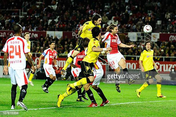 Neven Subotic of Borussia Dortmund scores his team's secong goal during the UEFA Europa League group J match between Sevilla and Borussia Dortmund at...