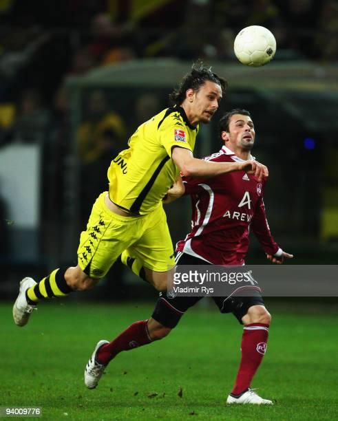 Neven Subotic of Dortmund and Albert Bunjaku of Nuernberg in action during the Bundesliga match between Borussia Dortmund and 1. FC Nuernberg at...