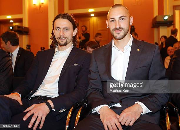 Neven Subotic of Dortmund and Diego Contento of Muenchen attend the DFB cup handover at Wappensaal of the Rote Rathaus on April 24 2014 in Berlin...