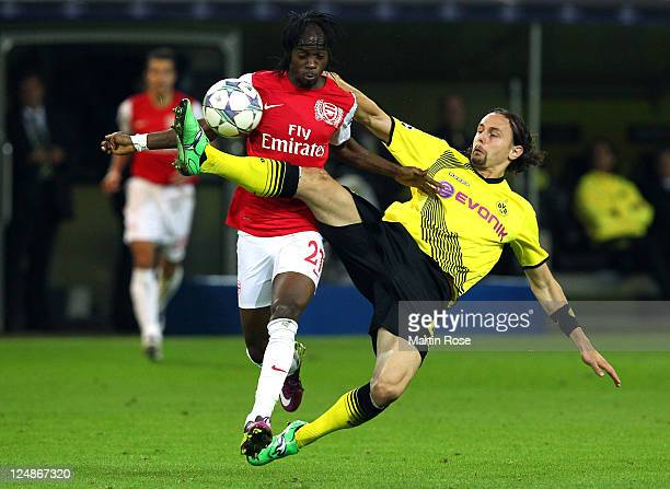 Neven Subotic of Dortmund and Gervinho of Arsenal battle for the ball during the Champions League Group F match between Borussia Dortmund and Arsenal...