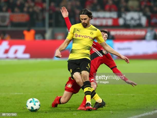 Neven Subotic of Dortmund and Kai Havertz of Leverkusen battle for the ball during the Bundesliga match between Bayer 04 Leverkusen and Borussia...