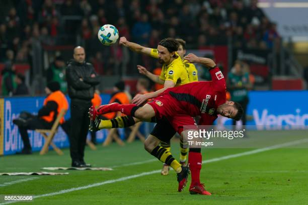Neven Subotic of Dortmund and Kevin Volland of Leverkusen battle for the ball during the Bundesliga match between Bayer 04 Leverkusen and Borussia...