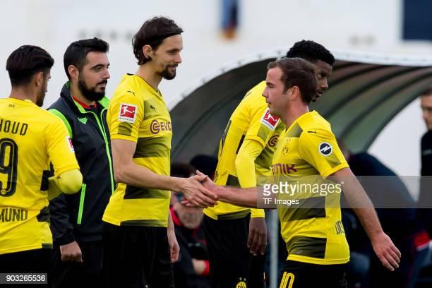 Neven Subotic of Dortmund and Mario Goetze of Dortmund shake hands during the Friendly match between Borussia Dortmund and SV Zulte Waregem at...