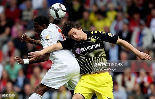 Neven Subotic of Dortmund and Mohamadou Idrissou of Freiburg jump for a header during the Bundesliga match between SC Freiburg and Borussia Dortmund...