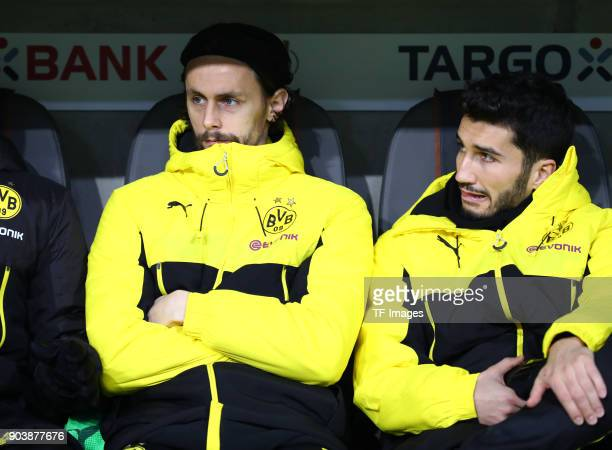 Neven Subotic of Dortmund and Nuri Sahin of Dortmund sit on the bench during the DFB Cup match between Bayern Muenchen and Borussia Dortmund at...