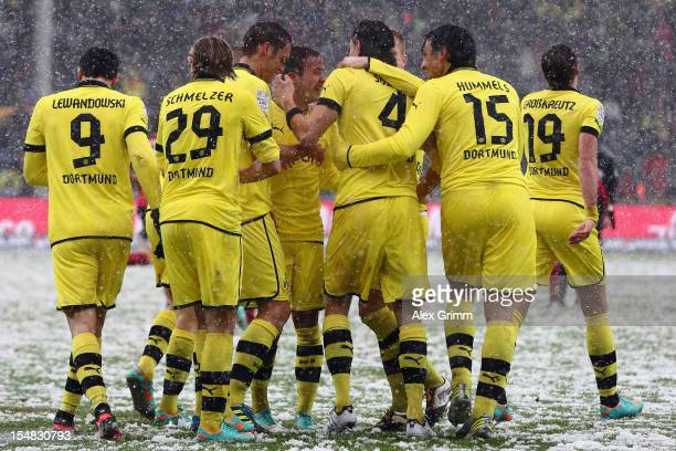 Neven Subotic of Dortmund celebrates his team's first goal with team mates during the Bundesliga match between SC Freiburg and Borussia Dortmund at...