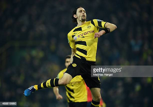 Neven Subotic of Dortmund celebrates with his team-mates after scoring his team's first goal during during the DFB Cup Quarter Final match between...