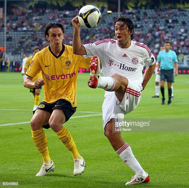 Neven Subotic of Dortmund challenges Luca Toni of Munich during the Supercup match between Borussia Dortmund and Bayern Munich at the Signal Iduna...