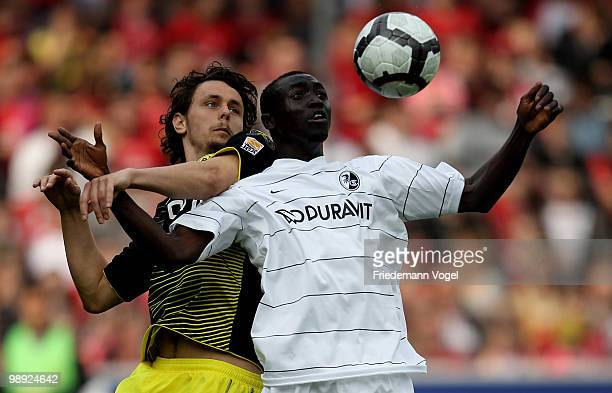 Neven Subotic of Dortmund fights for the ball with Papiss Cisse of Freiburg during the Bundesliga match between SC Freiburg and Borussia Dortmund at...