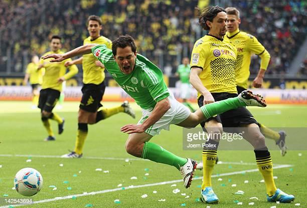 Neven Subotic of Dortmund fouls Marcel Schaefer of Wolfsburg during the Bundesliga match between VfL Wolfsburg and Borussia Dortmund at Volkswagen...