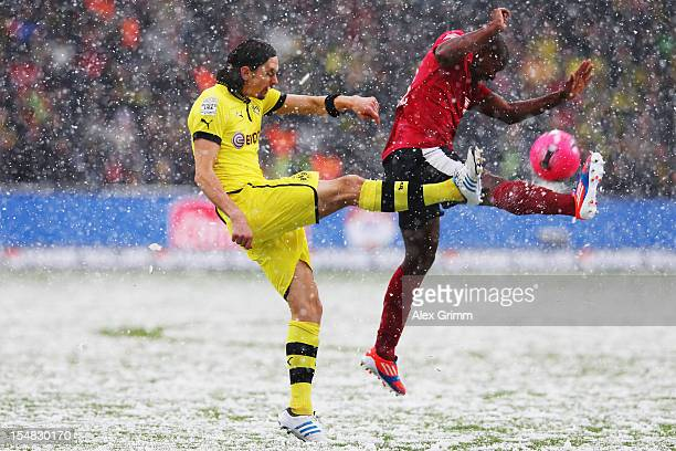 Neven Subotic of Dortmund is challenged by Karim Guede of Freiburg during the Bundesliga match between SC Freiburg and Borussia Dortmund at MAGE...