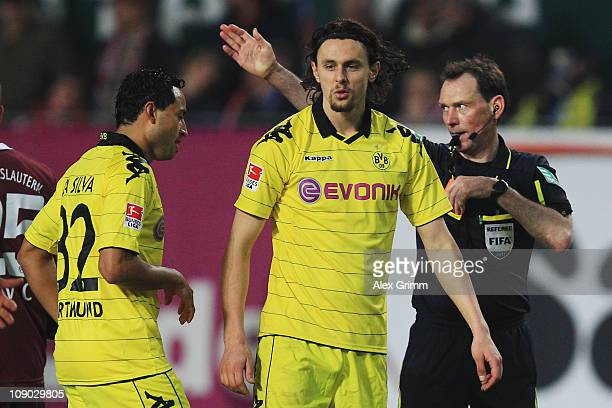 Neven Subotic of Dortmund is sent off by referee Florian Meyer during the Bundesliga match between 1. FC Kaiserslautern and Borussia Dortmund at...
