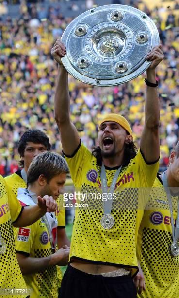 Neven Subotic of Dortmund lifts the trophy after the Bundesliga match between Borussia Dortmund and Eintracht Frankfurt at Signal Iduna Park on May...