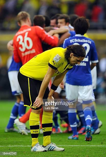 Neven Subotic of Dortmund looks dejected after loosing the Bundesliga match between Borussia Dortmund and FC Schalke 04 at Signal Iduna Park on...