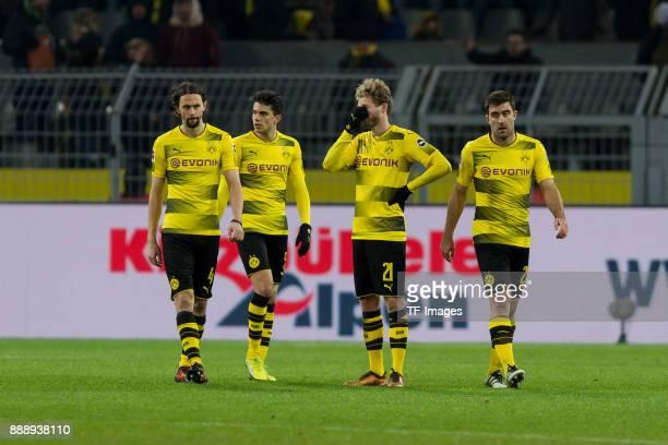 Neven Subotic of Dortmund Marc Bartra of Dortmund Andre Schuerrle of Dortmund and Sokratis of Dortmund look dejected after the Bundesliga match...