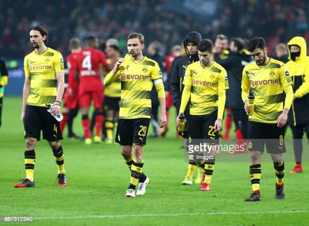 Neven Subotic of Dortmund Marcel Schmelzer of Dortmund Christian Pulisic of Dortmund and Nuri Sahin of Dortmund look dejected after the Bundesliga...