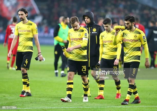 Neven Subotic of Dortmund Marcel Schmelzer of Dortmund Julian Weigl of Dortmund Christian Pulisic of Dortmund and Nuri Sahin of Dortmund look...