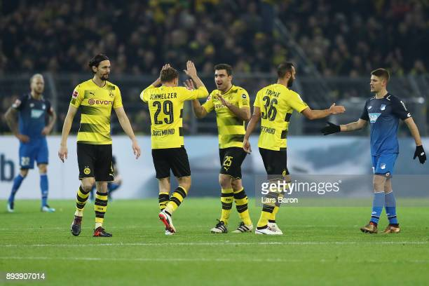 Neven Subotic of Dortmund Marcel Schmelzer of Dortmund Sokratis Papastathopoulos of Dortmund celebrate as Oemer Toprak of Dortmund shakes hands with...