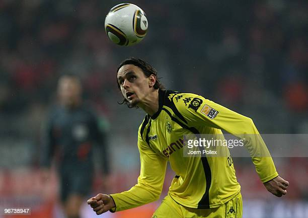 Neven Subotic of Dortmund plays the ball during the Bundesliga match between FC Bayern Muenchen and Borussia Dortmund at Allianz Arena on February...