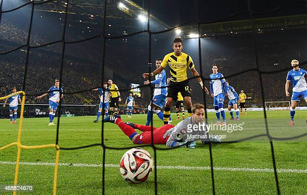 Neven Subotic of Dortmund scores his team's first goal past Tobias Strobl of Hoffenheim during the DFB Cup Quarter Final match between Borussia...