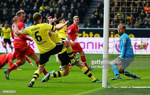 Neven Subotic of Dortmund scores his teams third goal during the Bundesliga match between Borussia Dortmund and FC Augsburg at Signal Iduna Park on...