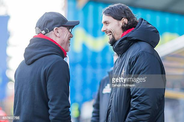 Neven Subotic of Koeln smiles as he chats with Head coach Peter Stoeger prior to the Bundesliga match between SV Darmstadt 98 and 1 FC Koeln at...