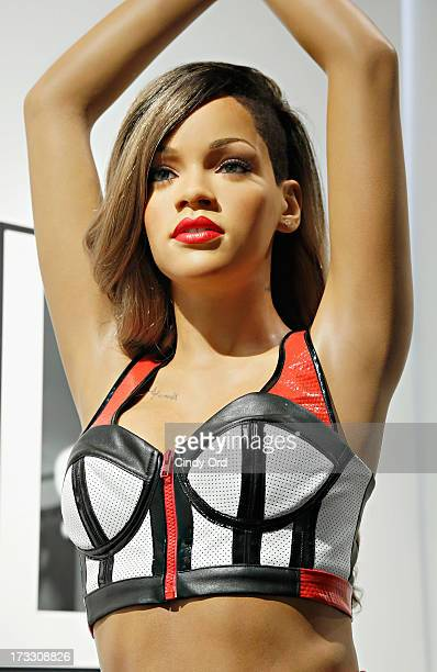 A never before seen Madame Tussauds New York wax figure of singer Rihanna is unveiled at famed SOHO tattoo parlor Sacred Tattoo on July 11 2013 in...