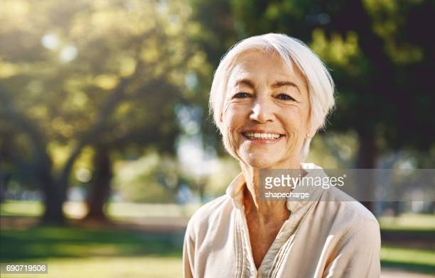 i never leave home without a smile - old woman stock pictures, royalty-free photos & images