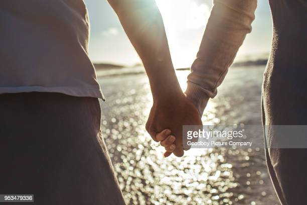 never let love go - holding hands stock pictures, royalty-free photos & images