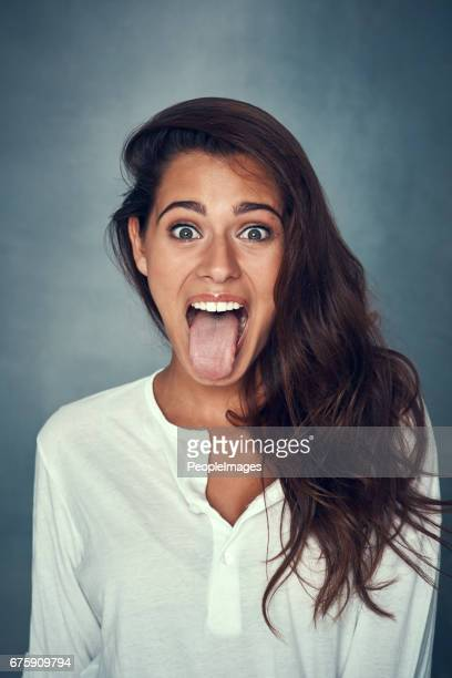never lose your playful side - woman long tongue stock photos and pictures