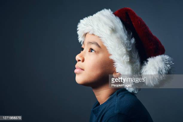 never stop believing in santa - one boy only stock pictures, royalty-free photos & images
