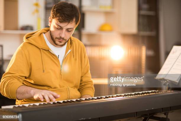 never too late to start playing an instrument - keyboard player stock photos and pictures