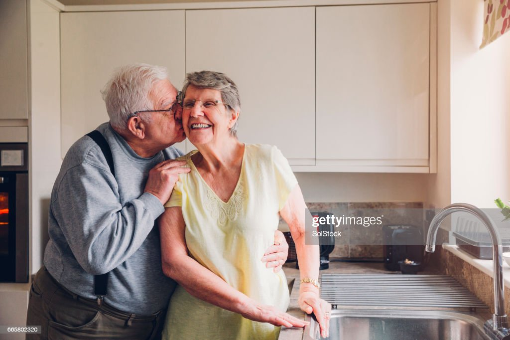 Never too old for a cheeky kiss! : Stock Photo