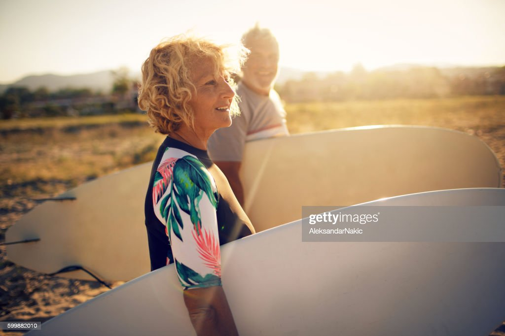 Never too old for surfing : Stock Photo
