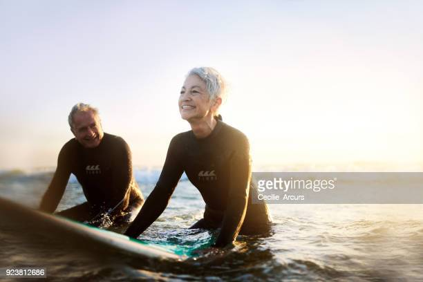 never too old to surf - surf stock pictures, royalty-free photos & images