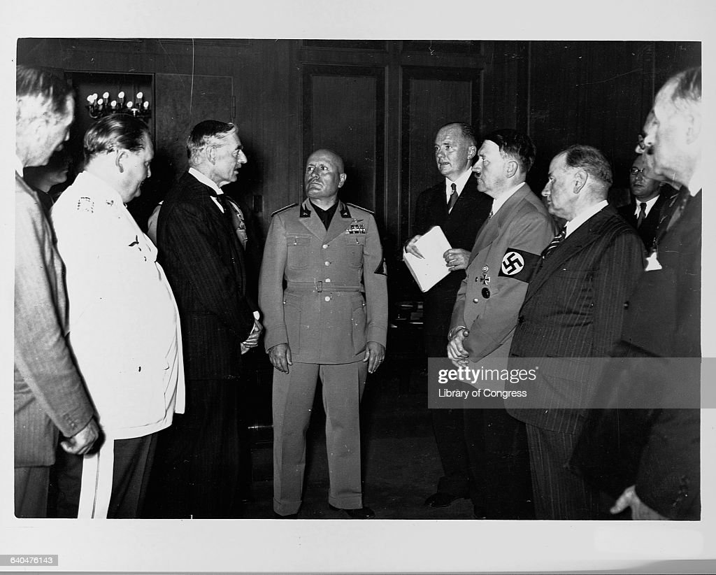 Neville Chamberlain, Adolph Hitler, Benito Mussolini, and Hermann Goering stand together at the Munich Conference in 1938.