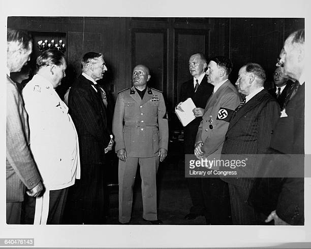 Neville Chamberlain Adolph Hitler Benito Mussolini and Hermann Goering stand together at the Munich Conference in 1938