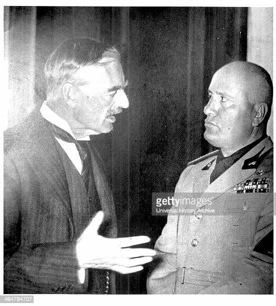 Neville Chamberlain, British Prime Minister, in conversation with the Italian dictator Benito Mussolini at Munich, 1938. Photograph