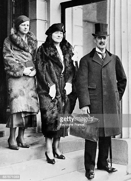 Neville Chamberlain Chancellor of the Exchequer accompanied by his wife and his daughter left the House of Commons in London United Kingdom circa 1930