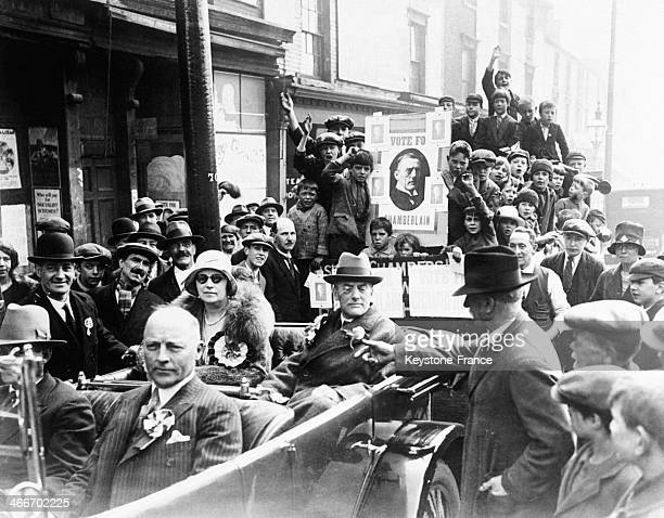 Neville Chamberlain with his wife Anne in a convertible car and supporters on election day in June 1929 in London United Kingdom