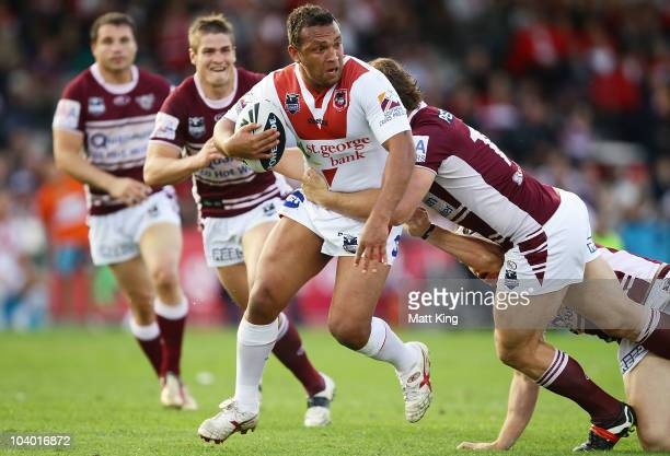 Neville Costigan of the Dragons takes on the defence during the NRL Fourth Qualifying Final match between the St George Illawarra Dragons and the...