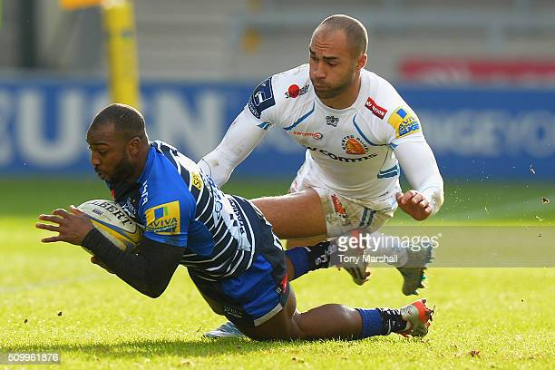 Neville Edwards of Sale Sharks tackled by Olly Woodburn of Exeter Chiefs during the Aviva Premiership match between Sale Sharks and Exeter Chiefs at...
