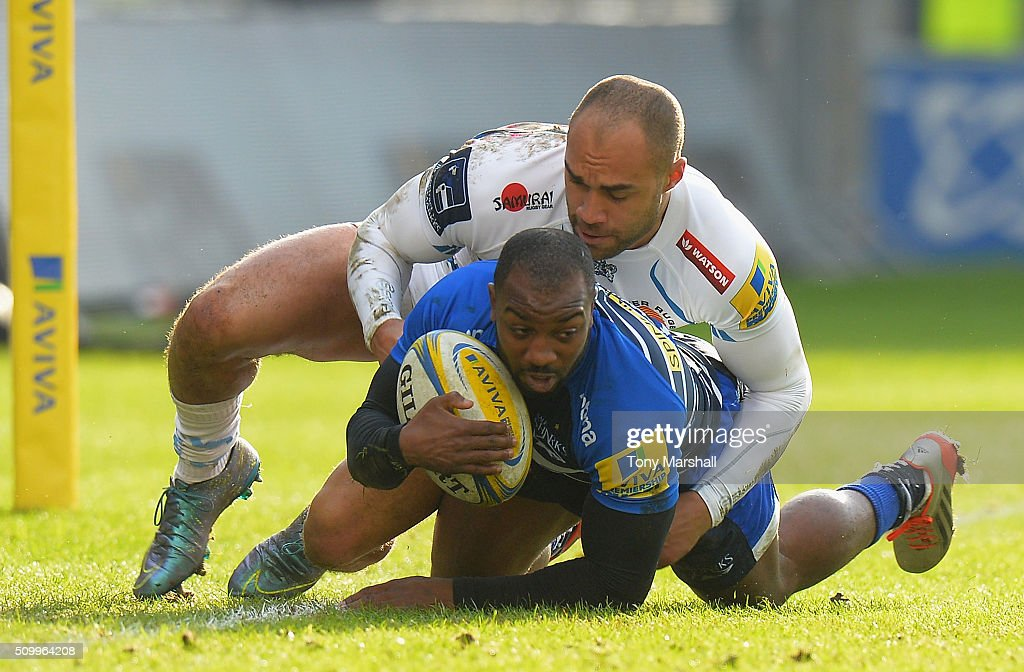 Neville Edwards of Sale Sharks tackled by Olly Woodburn of Exeter Chiefs during the Aviva Premiership match between Sale Sharks and Exeter Chiefs at the A J Bell Stadium on February 13, 2016 in Salford, England