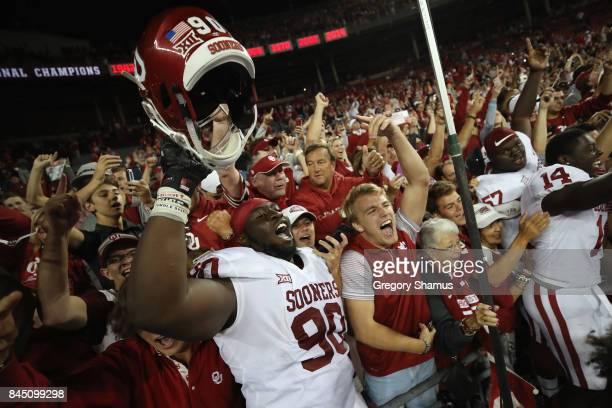 Neville Gallimore of the Oklahoma Sooners celebrates with fans after defeating the Ohio State Buckeyes 3116 at Ohio Stadium on September 9 2017 in...