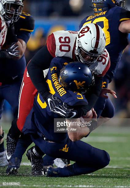 Neville Gallimore of the Oklahoma Sooners sacks Skyler Howard of the West Virginia Mountaineers in the second half on November 19 2016 at Mountaineer...