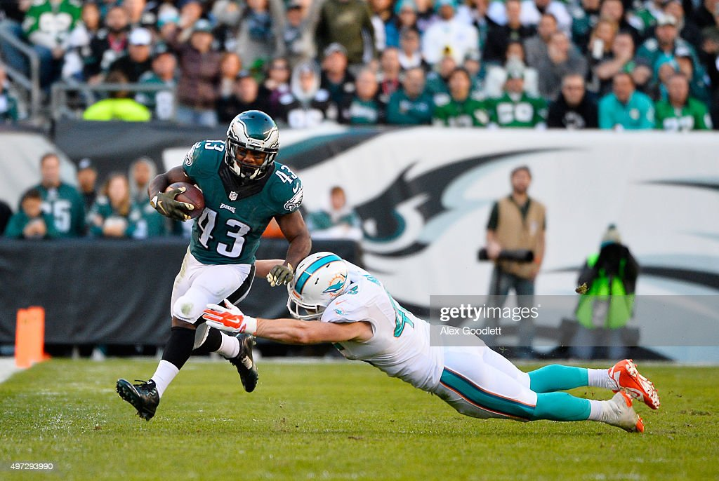 Neville Hewitt #46 of the Miami Dolphins chases Darren Sproles #43 of the Philadelphia Eagles in the third quarter at Lincoln Financial Field on November 15, 2015 in Philadelphia, Pennsylvania.