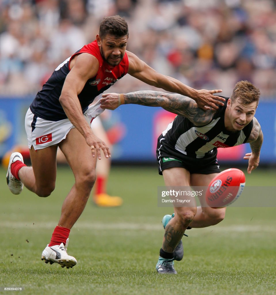 Neville Jetta of the Demons and Jamie Elliott of the Magpies compete for the ball during the round 23 AFL match between the Collingwood Magpies and the Melbourne Demons at Melbourne Cricket Ground on August 26, 2017 in Melbourne, Australia.