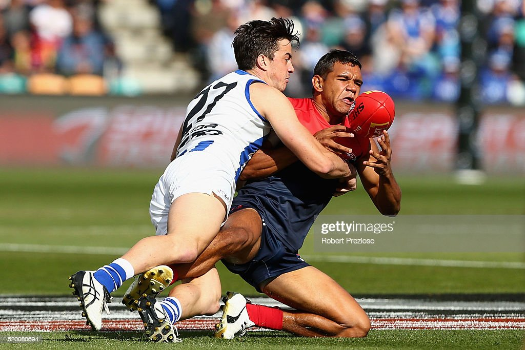 Neville Jetta of the Demons is tackled during the round three AFL match between the North Melbourne Kangaroos and the Melbourne Demons at Blundstone Arena on April 10, 2016 in Hobart, Australia.