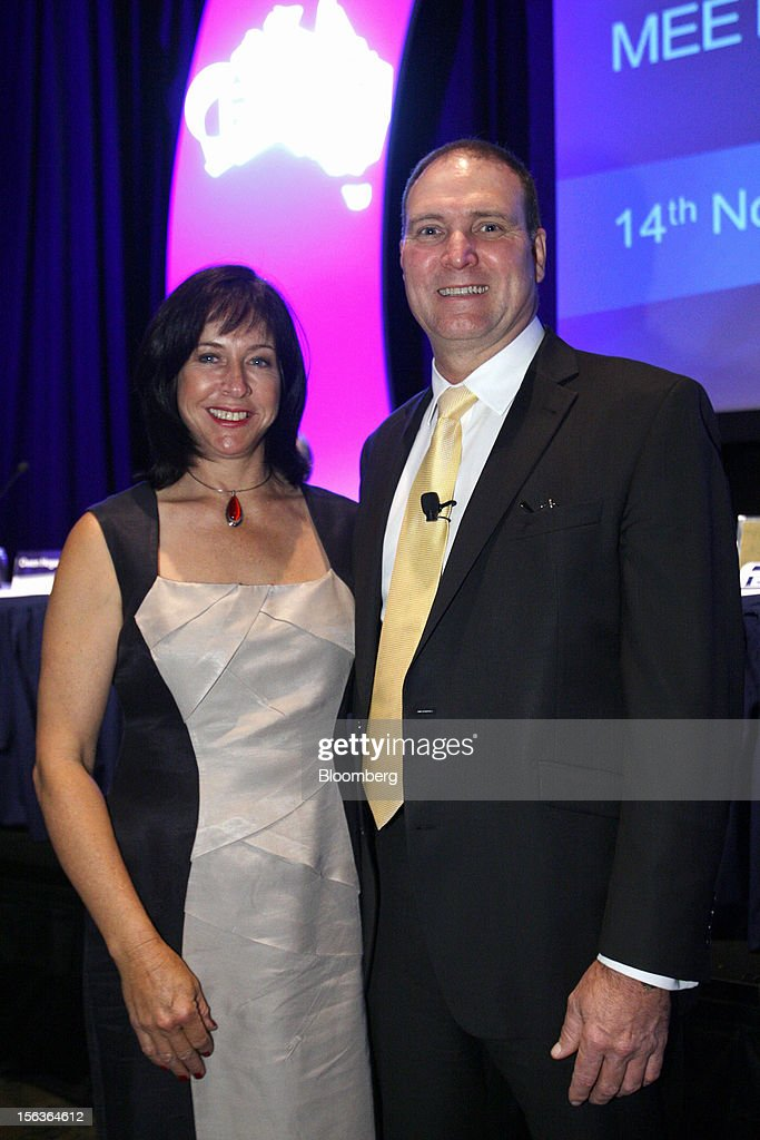Neville 'Nev' Power, chief executive officer of Fortescue Metals Group Ltd., stand for photographs with wife Irma at the company's annual general meeting in Perth, Australia, on Wednesday, Nov. 14, 2012. Andrew Forrest, founder of Fortescue Metals, last month defeated a regulator's claim that he misled shareholders of the iron-ore exporter which made him Australia's fourth-richest person. Photographer: Sergio Dionisio/Bloomberg via Getty Images
